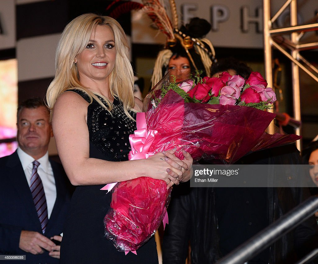 Singer <a gi-track='captionPersonalityLinkClicked' href=/galleries/search?phrase=Britney+Spears&family=editorial&specificpeople=156415 ng-click='$event.stopPropagation()'>Britney Spears</a> holds a bouquet of flowers at a welcome ceremony as she celebrates the release of her new album 'Britney Jean' and prepares for her two-year residency at Planet Hollywood Resort & Casino on December 3, 2013 in Las Vegas, Nevada. Spears' show 'Britney: Piece of Me' will debut at the resort on December 27, 2013.