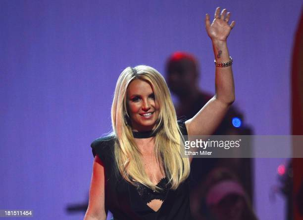 Singer Britney Spears introduces a performance by Miley Cyrus during the iHeartRadio Music Festival at the MGM Grand Garden Arena on September 21...
