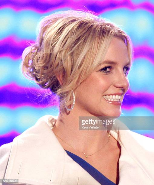 Singer Britney Spears lights the tree on stage at the 'Light of the Angels' Holiday Tree Lighting Ceremony at LA Live on December 4 2008 in Los...