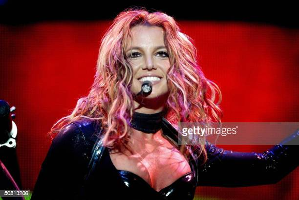 US singer Britney Spears performs in Rotterdam 07 May 2004 during her sole concert in the Netherlands for her 'The Onyx Hotel Tour' Spears' 2004...