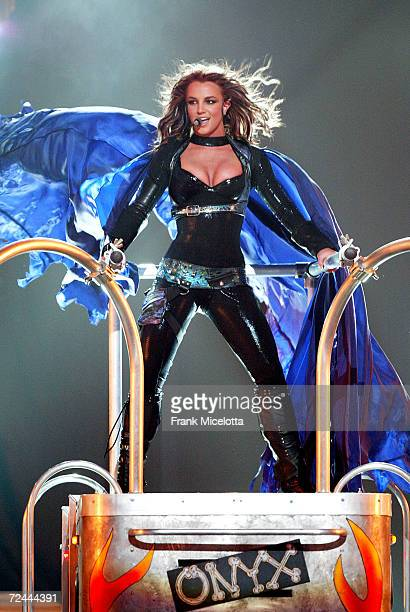 Singer Britney Spears performs onstage during Showtime's live broadcast of Britney's Onyx Hotel tour show at the American Airlines Arena March 28...