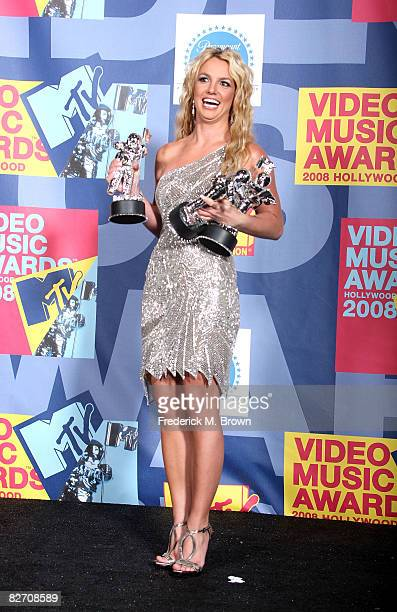 Singer Britney Spears poses with the Best Female Video Award Best Pop Award and Video of the Year Award for 'Piece of Me' in the press room at the...