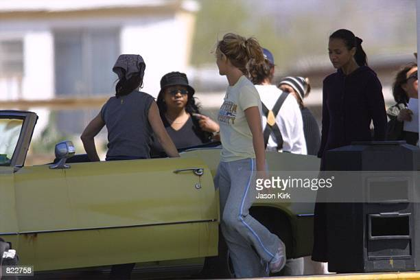 Singer Britney Spears walks around on the secured set of her upcoming and untitled movie March 22 2001 in Palmdale CA
