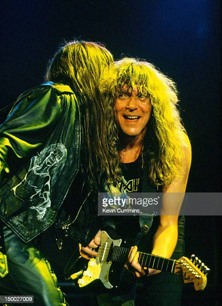 Singer Bruce Dickinson and guitarist Janick Gers performing with British heavy metal group Iron Maiden circa 1992