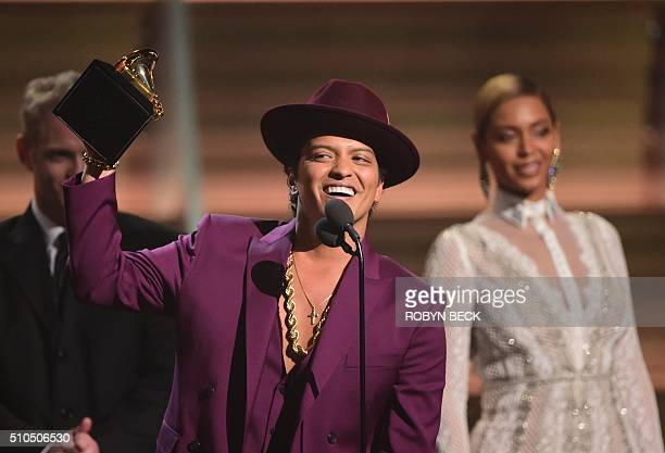 Singer Bruno Mars holds up the award for the Record of the Year Uptown Funk onstage during the 58th Annual Grammy music Awards in Los Angeles...