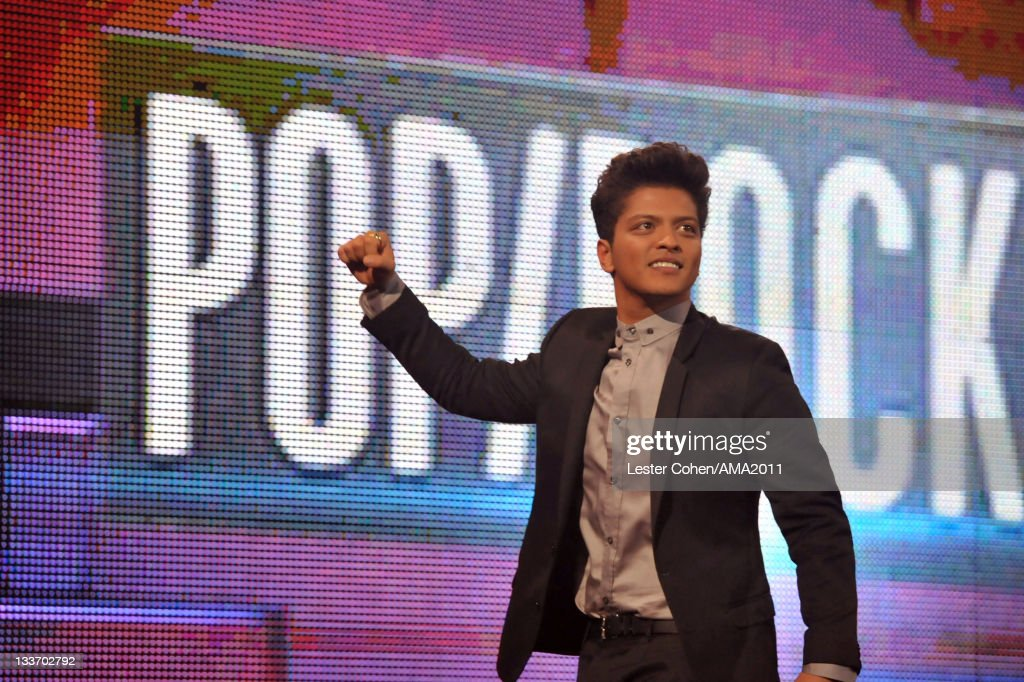 Singer <a gi-track='captionPersonalityLinkClicked' href=/galleries/search?phrase=Bruno+Mars&family=editorial&specificpeople=6779692 ng-click='$event.stopPropagation()'>Bruno Mars</a> onstage at the 2011 American Music Awards held at Nokia Theatre L.A. LIVE on November 20, 2011 in Los Angeles, California.