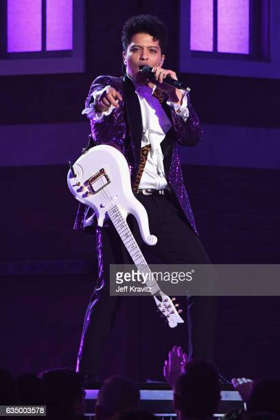 Singer Bruno Mars performs a tribute to the late Prince onstage during The 59th GRAMMY Awards at STAPLES Center on February 12 2017 in Los Angeles...