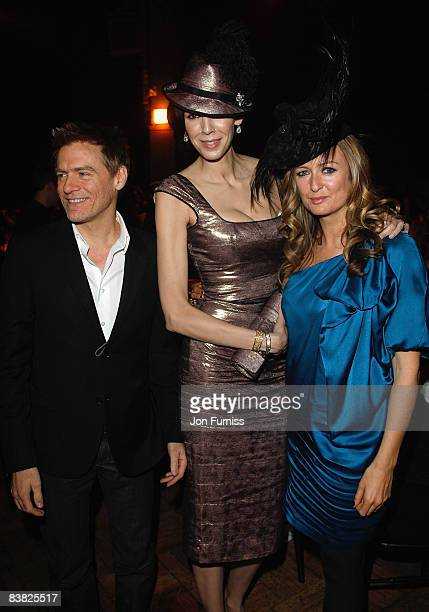 Singer Bryan Adams fashion designer L'Wren Scott and Editor of Harpers Bazaar Lucy Yeomans during the British Fashion Awards 2008 held at The...