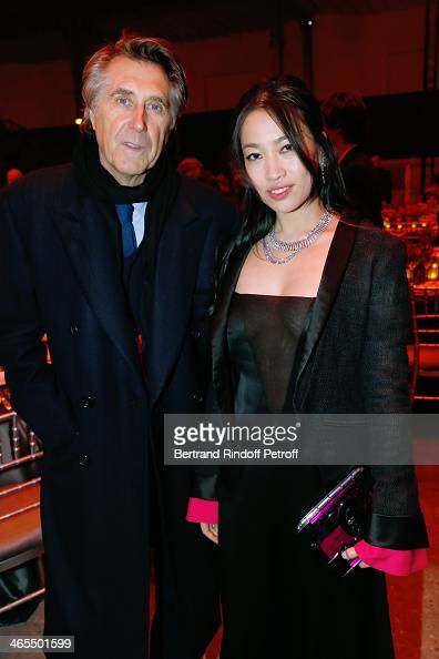 Singer Bryan Ferry and Yi Zhou with his son attend the 'Nuit De La Chine' Opening Night at Grand Palais on January 27 2014 in Paris France