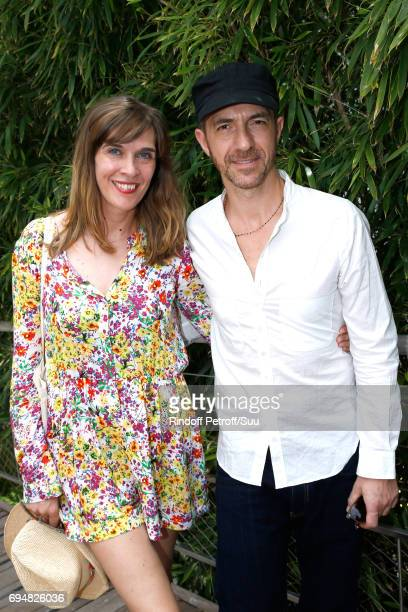 Singer Calogero and his companion Marie Bastide attend the Men Final of the 2017 French Tennis Open Day Fithteen at Roland Garros on June 11 2017 in...