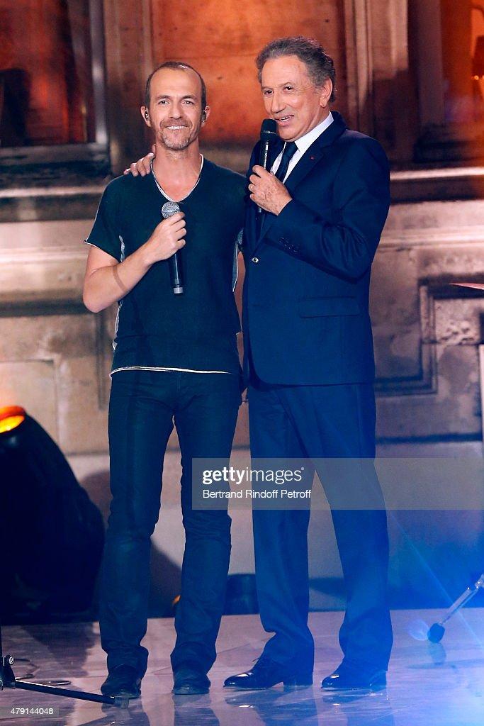 Singer Calogero and Presenter of the show Michel Drucker attend the 'Une Nuit avec la Police et la Gendarmerie' : France 2 TV Show. Held at Ministere de l'Interieur in Paris on June 30, 2015 in Paris, France.