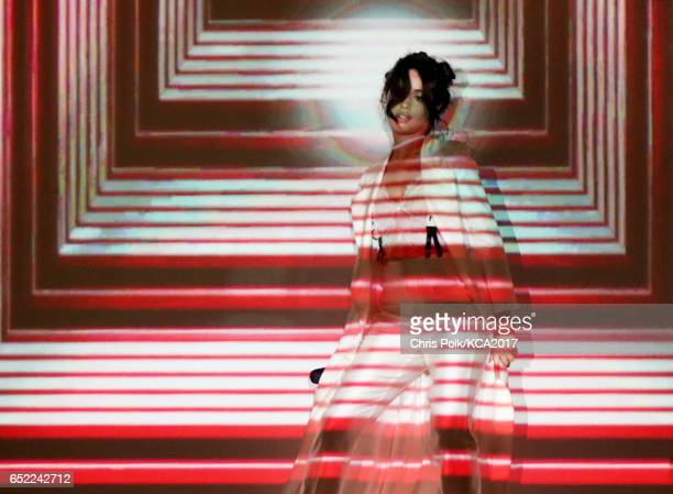 Singer Camila Cabello performs onstage at Nickelodeon's 2017 Kids' Choice Awards at USC Galen Center on March 11 2017 in Los Angeles California