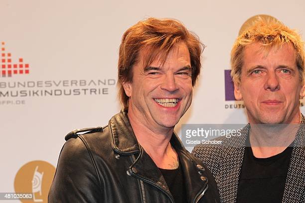 Singer Campino and Andreas Meurer of the band Die Toten Hosen pose on the red carpet prior the Echo award 2014 at Messe Berlin on March 27 2014 in...