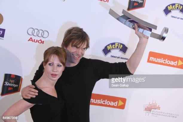 Singer Campino holds his Echo Award for his band Die Toten Hosen with actress Birgit Minichmayr in the pressroom at the 2009 Echo Music Awards on...