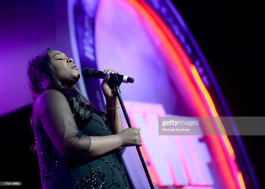 Singer Candice Glover performs onstage during Women In Film's 2013 Crystal + Lucy Awards at The Beverly Hilton Hotel on June 12, 2013 in Beverly Hills, California.