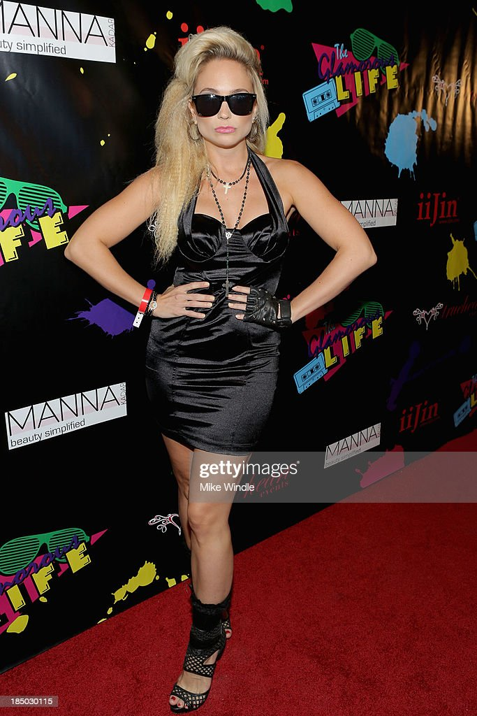 Singer Cara Quici arrives at iiJin's Spring/Summer 2014 'The Glamorous Life' clothing and footwear collection fashion show at Avalon on October 16, 2013 in Hollywood, California.