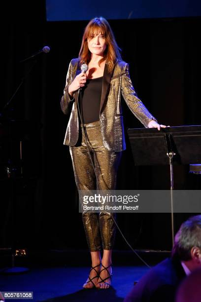 Singer Carla Bruni performs during the amfAR Paris Dinner 2017 at Le Petit Palais on July 2 2017 in Paris France
