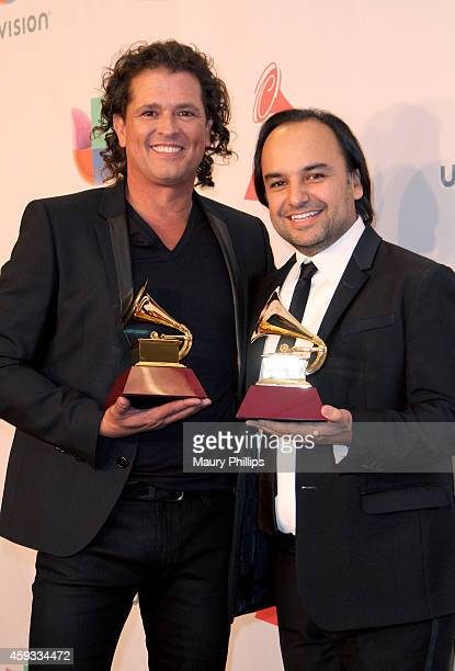 Singer Carlos Vives and producer Andres Castro winners of Best Tropical Album pose in the press room during the 15th annual Latin GRAMMY Awards at...