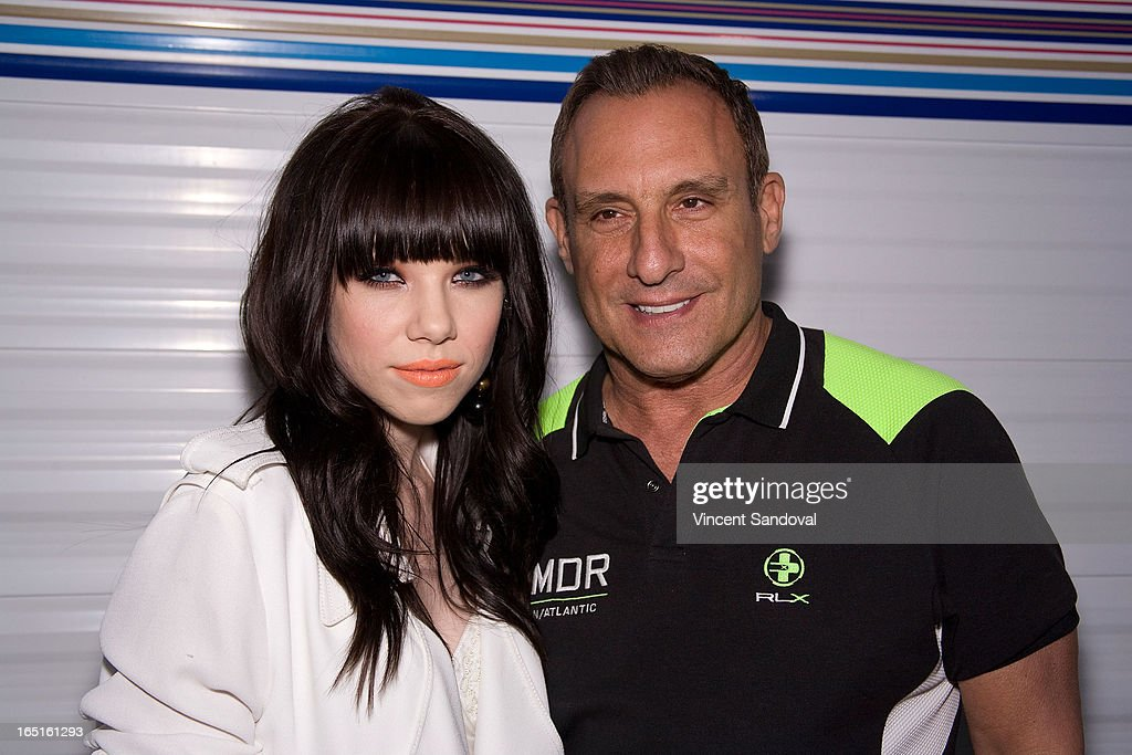 Singer Carly Rae Jepsen and Jeffrey Sanker attend the Circus Xtreme T-Dance during Jeffrey Sanker presents White Party Palm Springs 2013 Day 3 at the White Party Park on March 31, 2013 in Palm Springs, California.