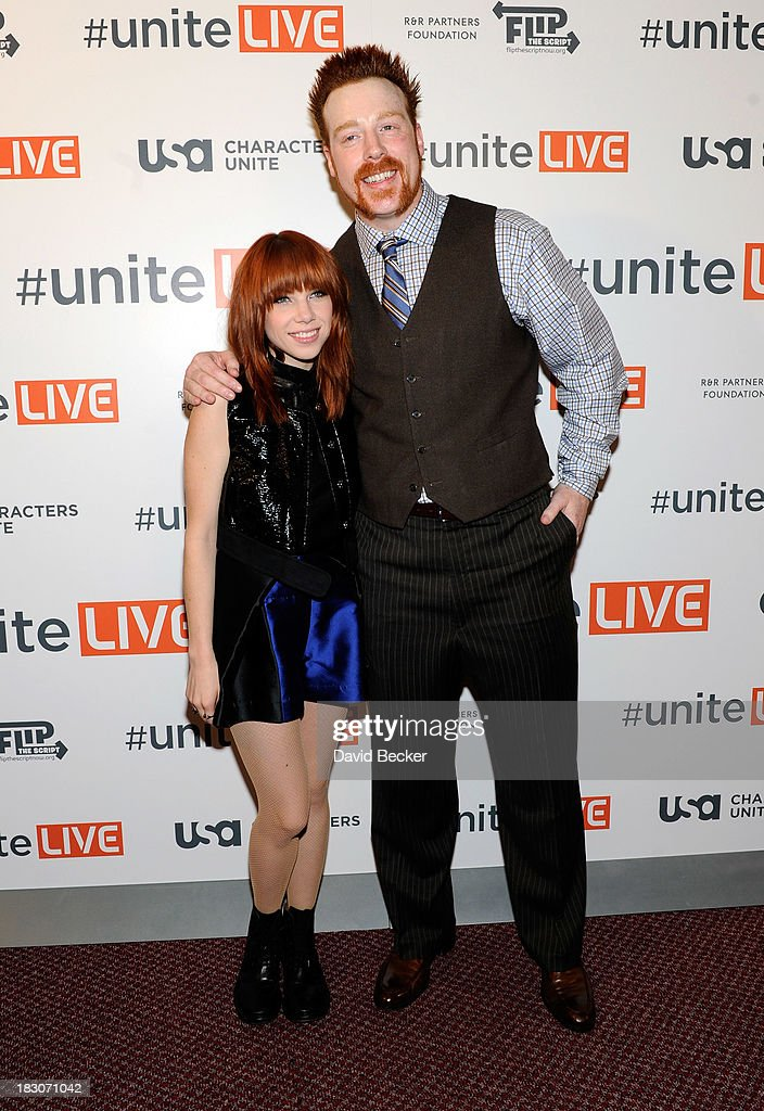 Singer Carly Rae Jepsen (L) and professional wrestler Sheamus arrive at the 'UniteLIVE: The Concert to Rock Out Bullying' at the Thomas & Mack Center on October 3, 2013 in Las Vegas, Nevada.