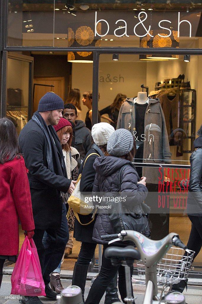 Singer Carly Rae Jepsen leaves the 'Bash' store on November 21, 2013 in Paris, France.