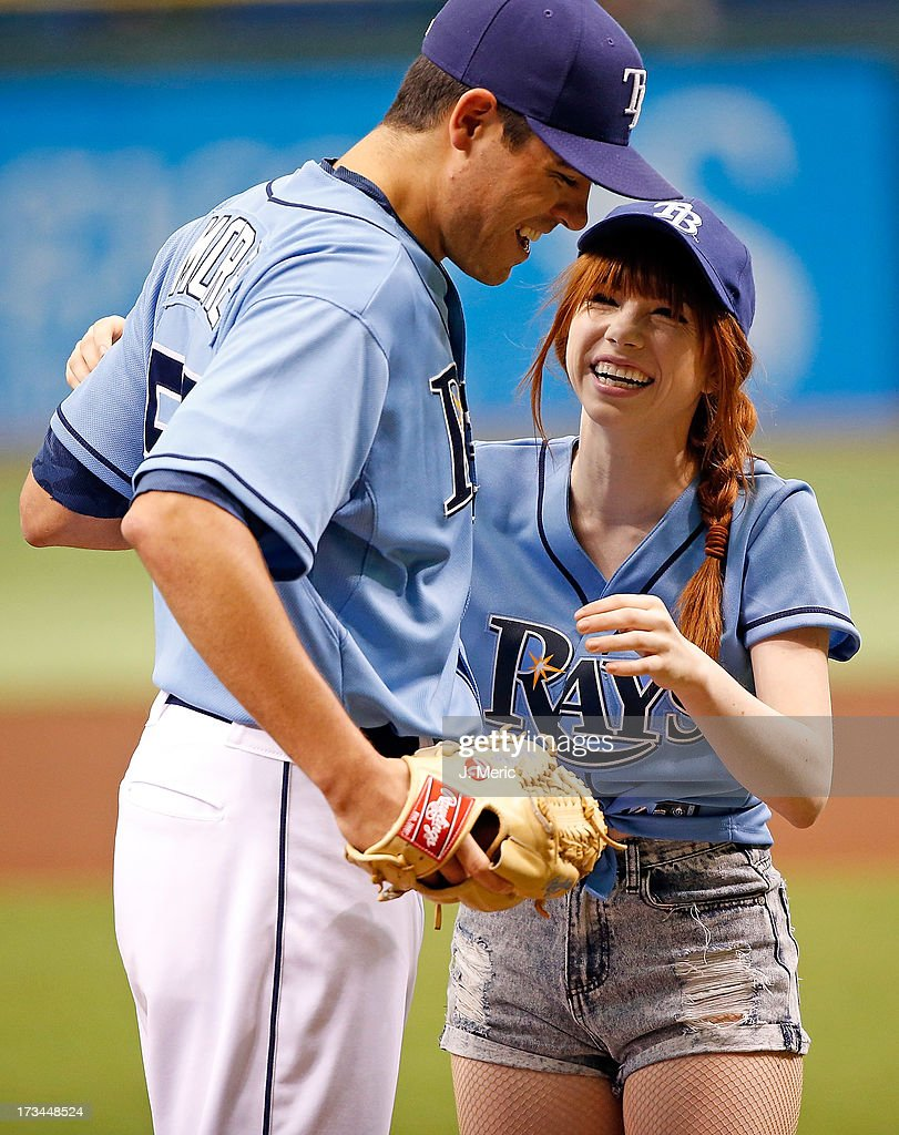 Singer Carly Rae Jepsen smiles with pitcher Matt Moore #55 just before the start of the game between the Tampa Bay Rays and the Houston Astros at Tropicana Field on July 14, 2013 in St. Petersburg, Florida.