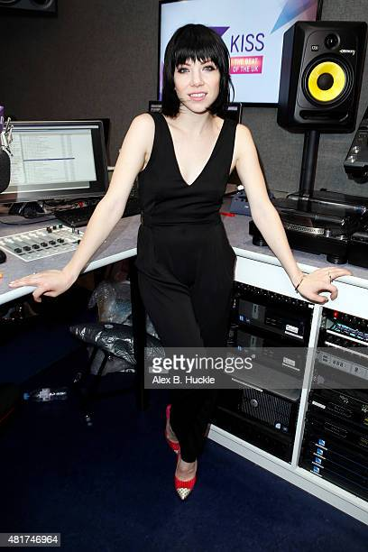 Singer Carly Rae Jepson poses for pictures during a visit to the Kiss FM Studios on July 24 2015 in London England