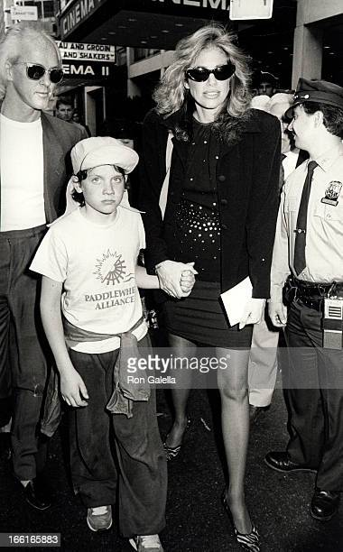 Singer Carly Simon son Benjamin Taylor and musician Russ Kunkel attending the premiere of 'Perfect' on May 29 1985 at the Coronet Theater in New York...