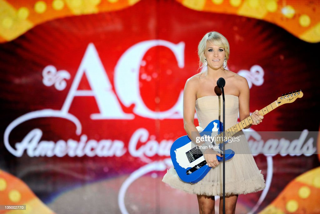 Singer <a gi-track='captionPersonalityLinkClicked' href=/galleries/search?phrase=Carrie+Underwood&family=editorial&specificpeople=204483 ng-click='$event.stopPropagation()'>Carrie Underwood</a> accepts the award for Artist of the Year: Female onstage at the American Country Awards 2011 at the MGM Grand Garden Arena on December 5, 2011 in Las Vegas, Nevada.
