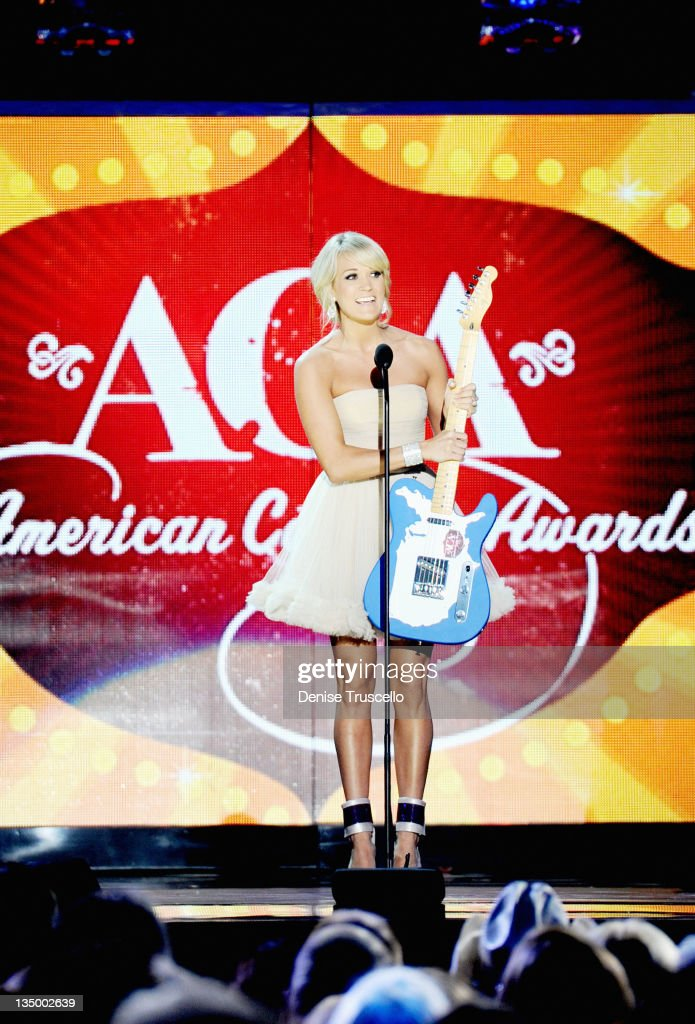 Singer <a gi-track='captionPersonalityLinkClicked' href=/galleries/search?phrase=Carrie+Underwood&family=editorial&specificpeople=204483 ng-click='$event.stopPropagation()'>Carrie Underwood</a> accepts the award for Female Artist of the Year onstage during the 2011 American Country Awards at MGM Grand Garden Arena on December 5, 2011 in Las Vegas, Nevada.