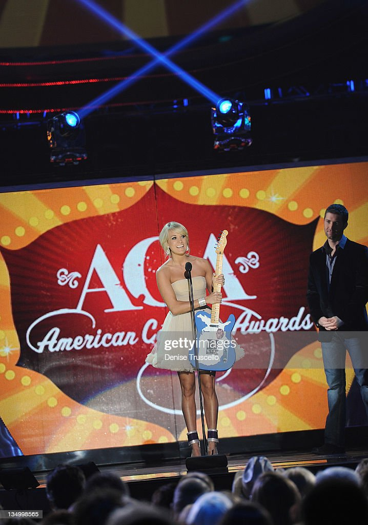 Singer <a gi-track='captionPersonalityLinkClicked' href=/galleries/search?phrase=Carrie+Underwood&family=editorial&specificpeople=204483 ng-click='$event.stopPropagation()'>Carrie Underwood</a> accepts the award for Single By a Female Artist onstage during the 2011 American Country Awards at MGM Grand Garden Arena on December 5, 2011 in Las Vegas, Nevada.