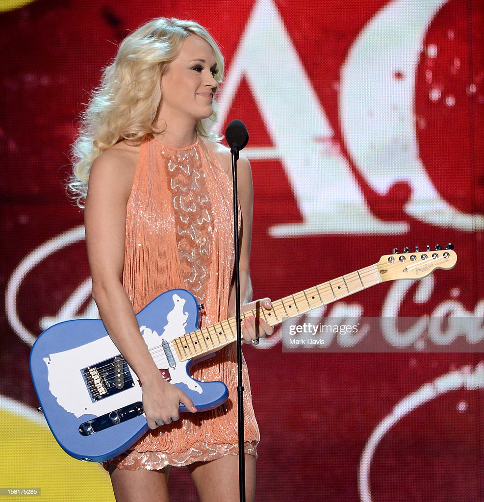 Singer Carrie Underwood accepts the Female Artist of the Year award onstage during the 2012 American Country Awards at the Mandalay Bay Events Center on December 10, 2012 in Las Vegas, Nevada.