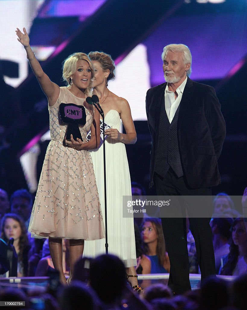 Singer Carrie Underwood accepts the trophy for 'Video of the Year' during the 2013 CMT Music awards at the Bridgestone Arena on June 5, 2013 in Nashville, Tennessee.