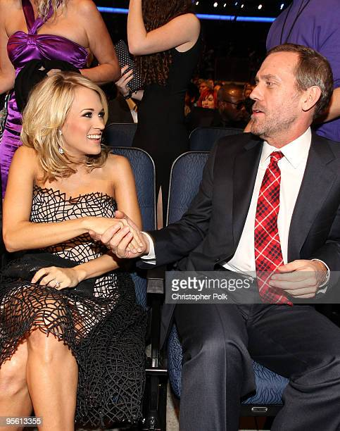 Singer Carrie Underwood and actor Hugh Laurie pose in the audience during the People's Choice Awards 2010 held at Nokia Theatre LA Live on January 6...