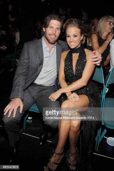 Singer Carrie Underwood and hockey player Mike Fisher attend the 2014 Billboard Music Awards at the MGM Grand Garden Arena on May 18 2014 in Las...