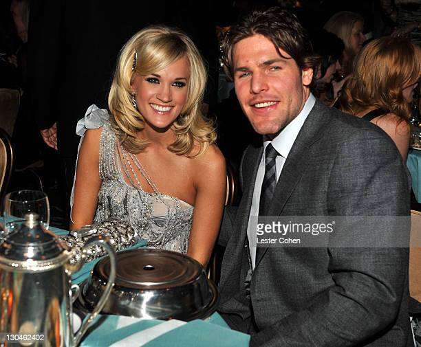 Singer Carrie Underwood and hockey Player Mike Fisher onstage during the 52nd Annual GRAMMY Awards Salute To Icons Honoring Doug Morris held at The...
