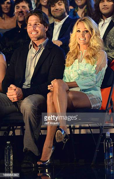 Singer Carrie Underwood and husband Mike Fisher attend the 2013 CMT Music Awards at the Bridgestone Arena on June 5 2013 in Nashville Tennessee