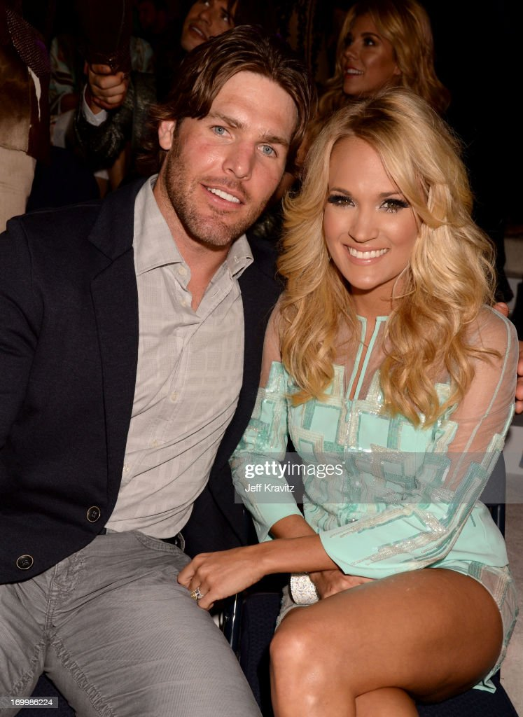 Singer <a gi-track='captionPersonalityLinkClicked' href=/galleries/search?phrase=Carrie+Underwood&family=editorial&specificpeople=204483 ng-click='$event.stopPropagation()'>Carrie Underwood</a> (R) and husband <a gi-track='captionPersonalityLinkClicked' href=/galleries/search?phrase=Mike+Fisher+-+Ice+Hockey+Player&family=editorial&specificpeople=204732 ng-click='$event.stopPropagation()'>Mike Fisher</a> attend the 2013 CMT Music Awards at the Bridgestone Arena on June 5, 2013 in Nashville, Tennessee.