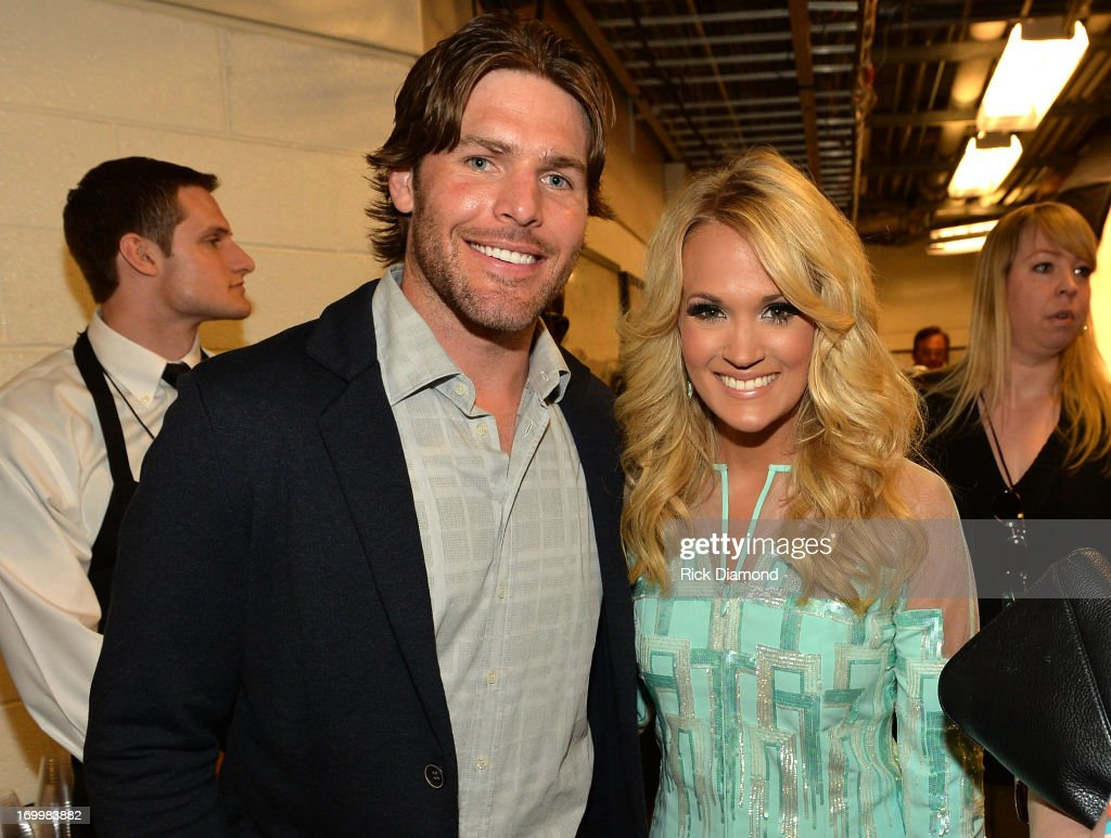 Singer <a gi-track='captionPersonalityLinkClicked' href=/galleries/search?phrase=Carrie+Underwood&family=editorial&specificpeople=204483 ng-click='$event.stopPropagation()'>Carrie Underwood</a> (R) and <a gi-track='captionPersonalityLinkClicked' href=/galleries/search?phrase=Mike+Fisher&family=editorial&specificpeople=204732 ng-click='$event.stopPropagation()'>Mike Fisher</a> attend the 2013 CMT Music awards at the Bridgestone Arena on June 5, 2013 in Nashville, Tennessee.