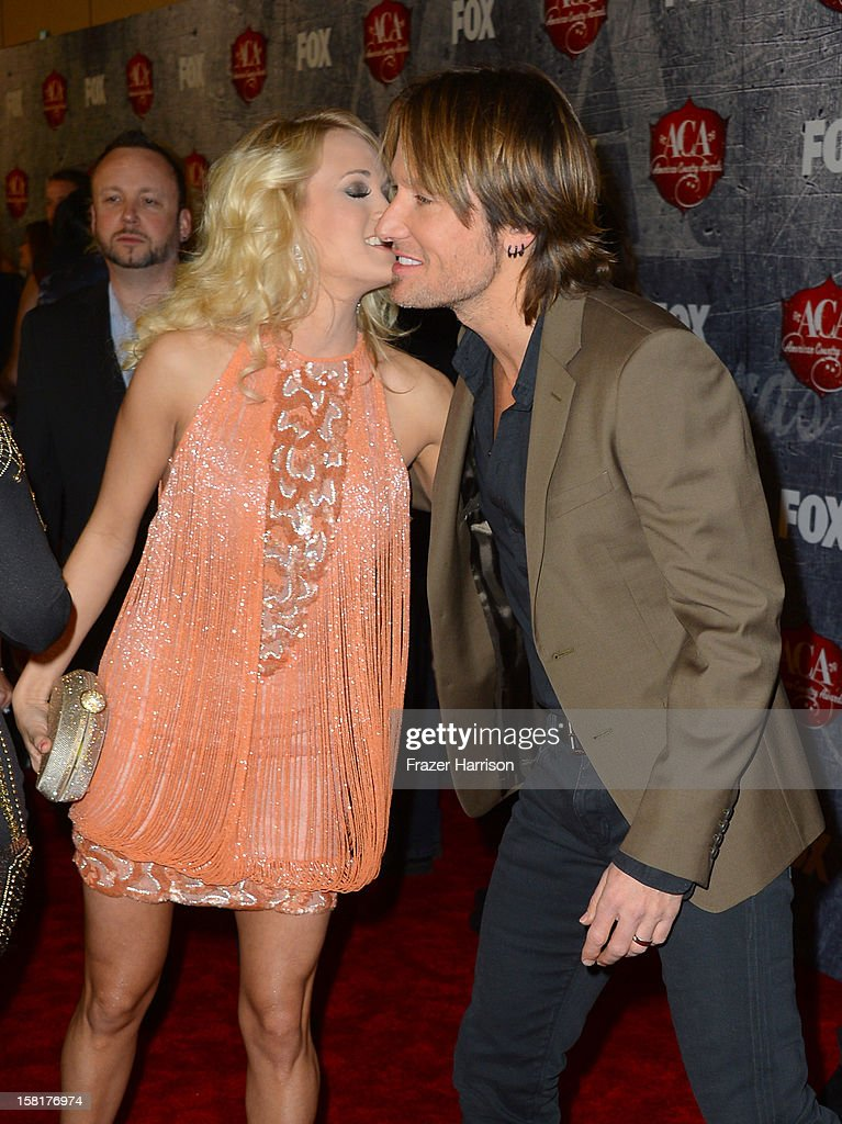 Singer Carrie Underwood (L) and musician/actor Keith Urban arrive at the 2012 American Country Awards at the Mandalay Bay Events Center on December 10, 2012 in Las Vegas, Nevada.