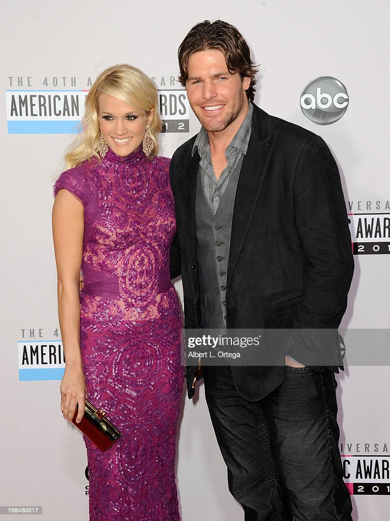 Singer Carrie Underwood and NHL player Mike Fisher arrive for the 40th Anniversary American Music Awards - Arrivals held at Nokia Theater L.A. Live on November 18, 2012 in Los Angeles, California.