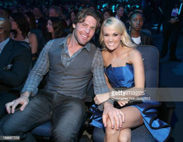 Singer Carrie Underwood and NHL player Mike Fisher at the 40th American Music Awards held at Nokia Theatre LA Live on November 18 2012 in Los Angeles...