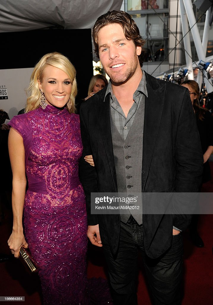 Singer Carrie Underwood (L) and NHL player Mike Fisher attend the 40th American Music Awards held at Nokia Theatre L.A. Live on November 18, 2012 in Los Angeles, California.
