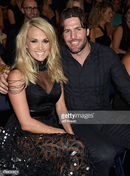 Singer Carrie Underwood and NHL player Mike Fisher attends the 2015 CMT Music awards at the Bridgestone Arena on June 10 2015 in Nashville Tennessee