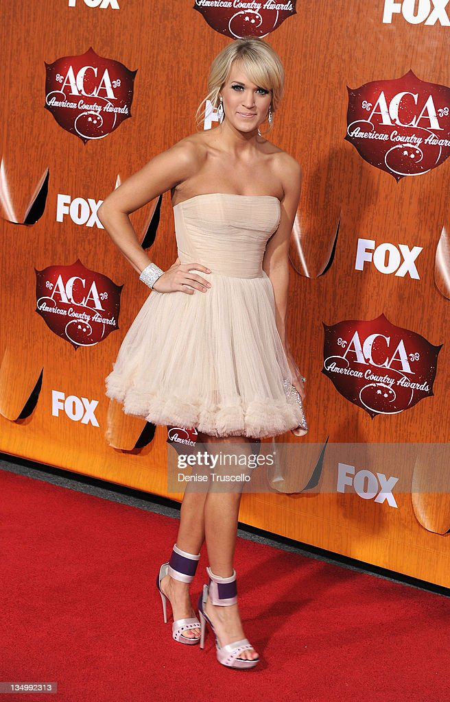 Singer <a gi-track='captionPersonalityLinkClicked' href=/galleries/search?phrase=Carrie+Underwood&family=editorial&specificpeople=204483 ng-click='$event.stopPropagation()'>Carrie Underwood</a> arrives at 2011 American Country Awards at MGM Grand Garden Arena on December 5, 2011 in Las Vegas, Nevada.