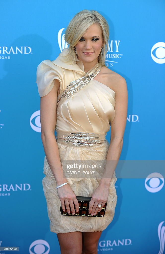 Singer <a gi-track='captionPersonalityLinkClicked' href=/galleries/search?phrase=Carrie+Underwood&family=editorial&specificpeople=204483 ng-click='$event.stopPropagation()'>Carrie Underwood</a> arrives at the 45th Academy of Country Music Awards in Las Vegas, Nevada, on April 18, 2010.