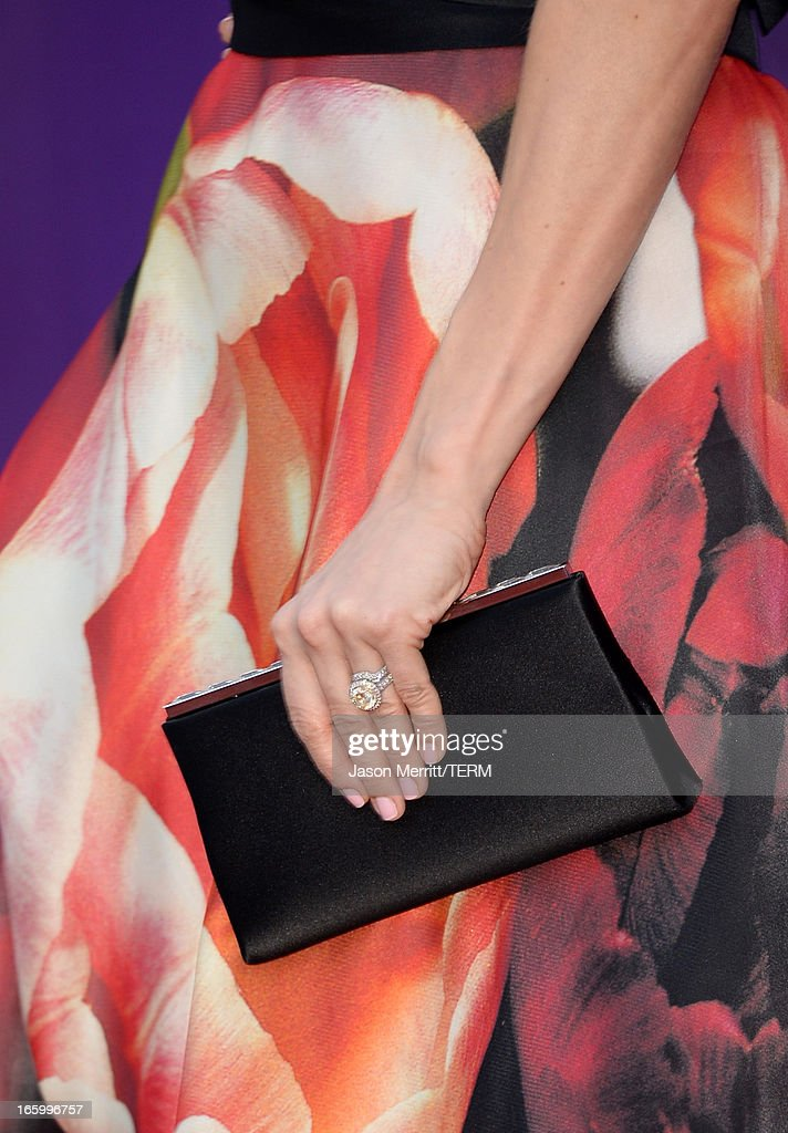 Singer Carrie Underwood (handbag detail) arrives at the 48th Annual Academy of Country Music Awards at the MGM Grand Garden Arena on April 7, 2013 in Las Vegas, Nevada.