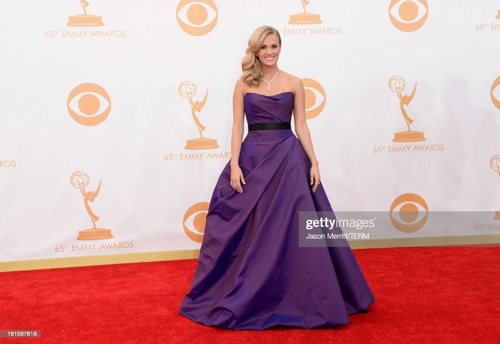 Singer Carrie Underwood arrives at the 65th Annual Primetime Emmy Awards held at Nokia Theatre LA Live on September 22 2013 in Los Angeles California