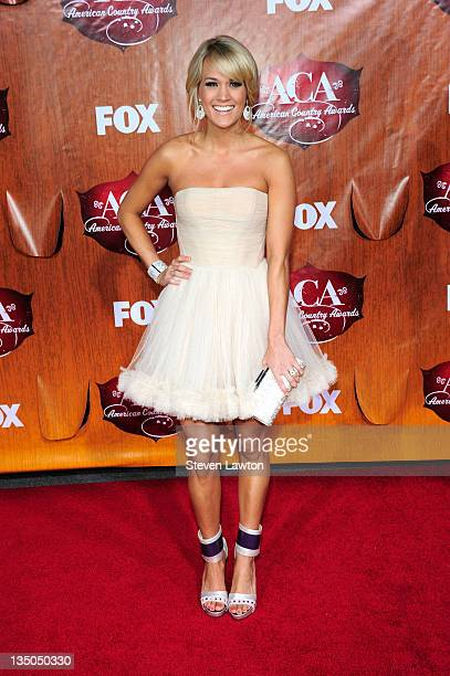 Singer Carrie Underwood arrives for the American Country Awards at the MGM Grand Garden Arena on December 5 2011 in Las Vegas Nevada