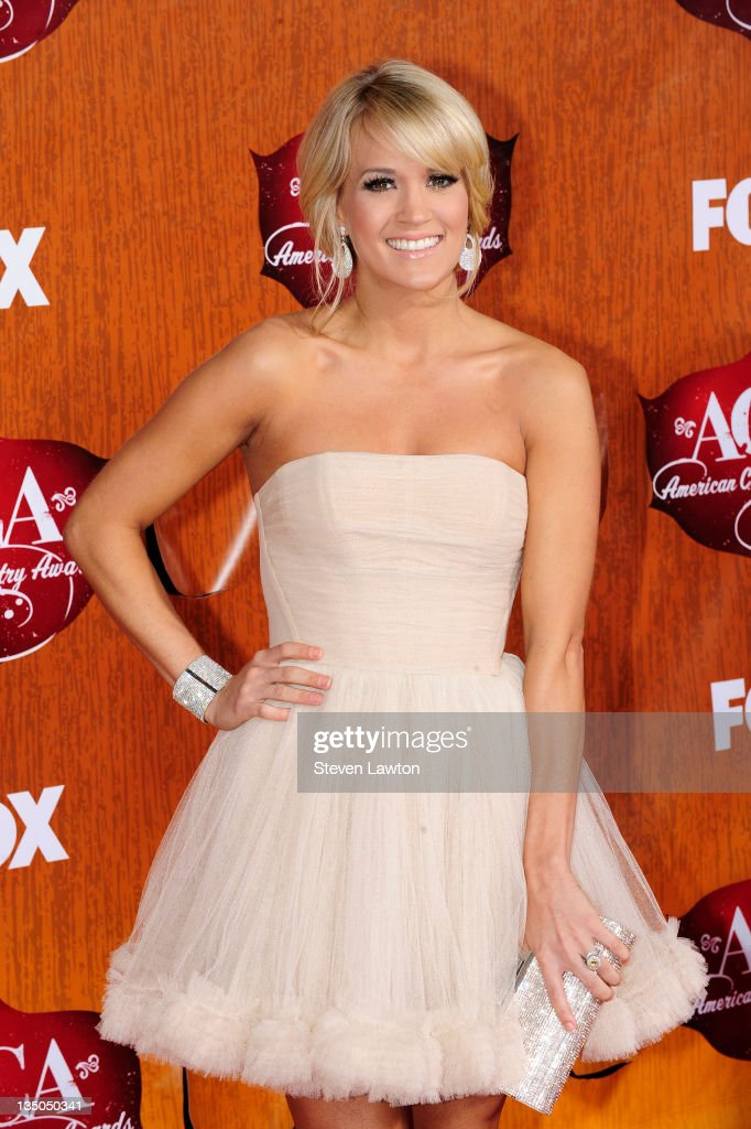 Singer <a gi-track='captionPersonalityLinkClicked' href=/galleries/search?phrase=Carrie+Underwood&family=editorial&specificpeople=204483 ng-click='$event.stopPropagation()'>Carrie Underwood</a> arrives for the American Country Awards at the MGM Grand Garden Arena on December 5, 2011 in Las Vegas, Nevada.